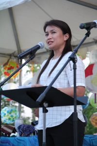 April Mercado speaking to participants of the General Conference Climate Vigil. Photo by Jesse Love.