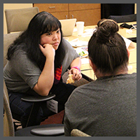 Pastor Karen Yokota Love and the Rev. Terri Stewart process ideas in-between sessions at Multiplying Ministries.