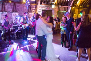 Hampshire Wedding Band The Pocket Rockers perform the first dance for a Wedding at Dancing Man Brewery. The bride and groom are dancing together.
