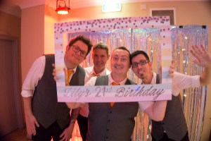 Hampshire Wedding Band The Pocket Rockers taking a photo at a 21st birthday party using a picutre frame dedicated to Lily's 21st Birthday.