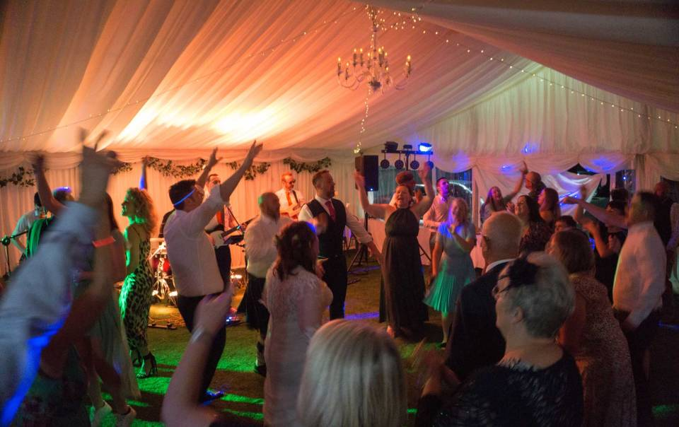 The Pocket Rockers performing at a Wedding at The Hampshire Hog, All of the guests are dancing and having a great time