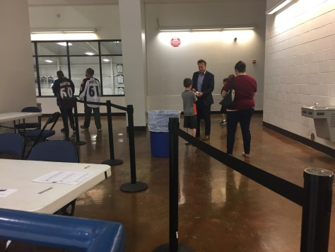 Joe Sakic being chased down by adoring kids who don't find that creepy.