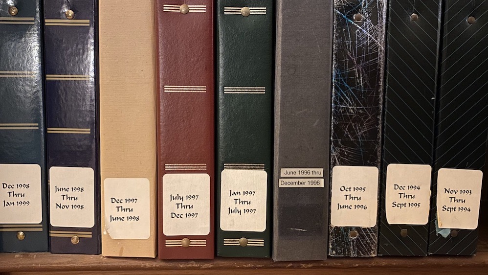 dusty old photo albums with nice labels by date