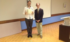 "<p style=""text-align: center;"">Derek accepting his 2nd place Humorous Speech Contest Award</p>"