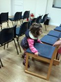 3-years-old, Nicole Dekel, helping sort the chairs for the 21st Sep meeting...