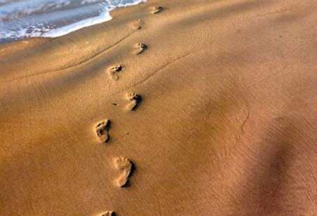 footprints in sand - I Still Haven't Found What I'm Looking For