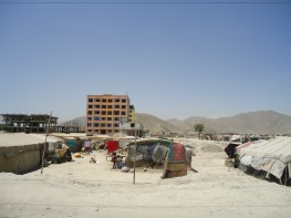 Families living in tents outside an apartment complex in Kabul