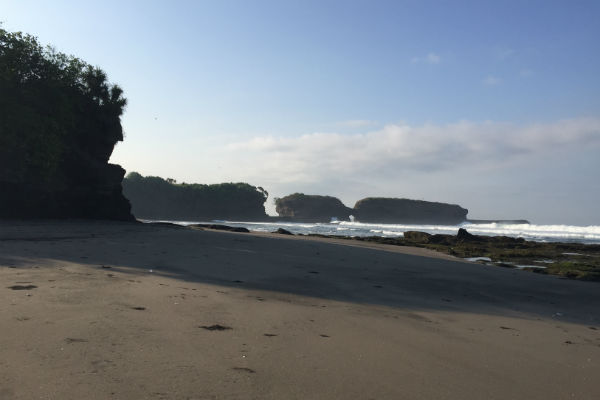 The black sand beach in front of Villa Bulung Daya