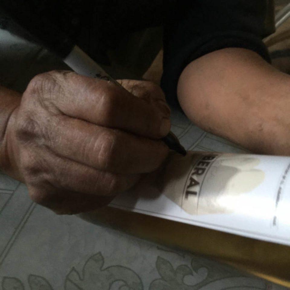 signing of mezcal label, oaxacan m