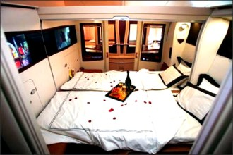 Our seats in bed mode! Yes, it's like a double bed in the sky!