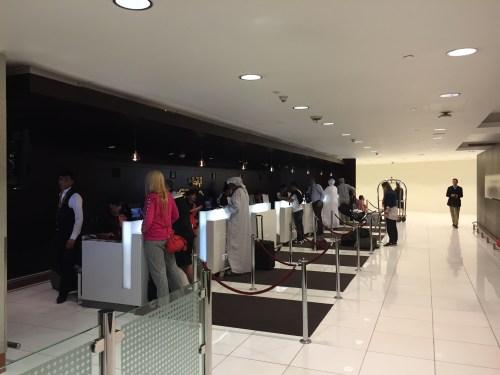 etihad first business class lounge premium abu dhabi auh chauffeur food champagne check-in