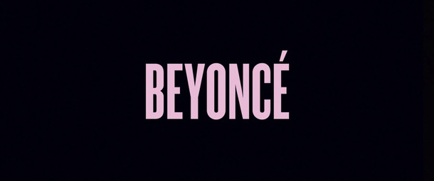 """Detail from the cover art of Beyoncé Knowles new self-titled album. The image is simply a black background, at the centre is the title """"Beyoncé"""" in a pale pink in a sans serif font."""