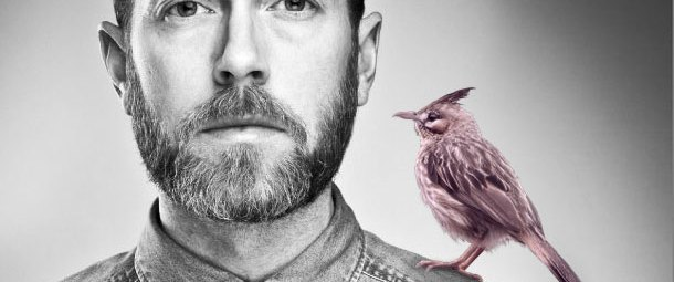 An image for Kiss Me Tonight featuring Ryan MacGrath with a pink lark on his shoulder.