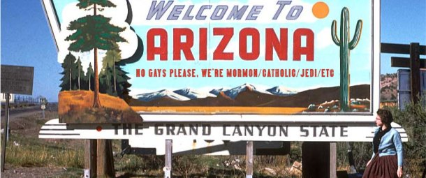 A vintage image of a Welcom To Arizona sign which has been altered to say that Gays are not welcome due to religious beliefs.