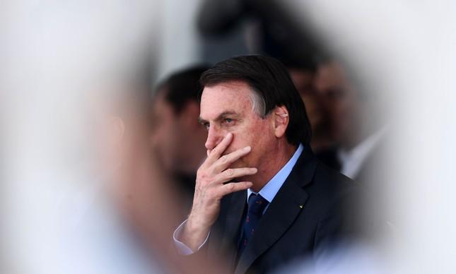 87700123 in this file picture taken on december 13 2019 brazilian president jair bolsonaro attends t - Bolsonaro sobre o lockdown: 'Brasil está se tornando um País de pobres'