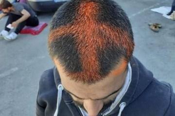 Polícia marca imigrantes com cruz na cabeça como 'cura para o coronavírus'