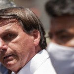 x90674722 Brazilian President Jair Bolsonaro gestures after voting during the second round of mun.jpg.pagespeed.ic .3F htxrAnm - 'Não será comprada': veja 10 vezes em que Bolsonaro criticou a CoronaVac