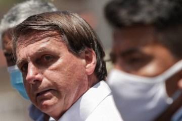 x90674722 Brazilian President Jair Bolsonaro gestures after voting during the second round of mun.jpg.pagespeed.ic .3F htxrAnm - 'Não será comprada': veja 10 vezes em que Bolsonaro criticou a CoronaVac