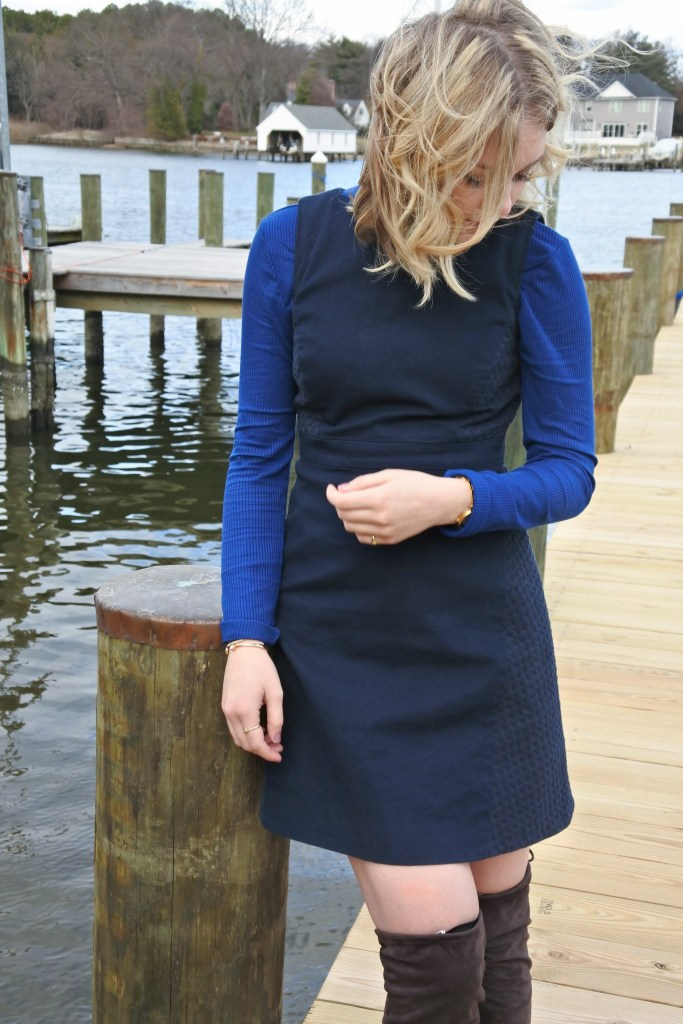 Layer a turtleneck under a sleeveless dress for a cute and colorful cold weather outfit