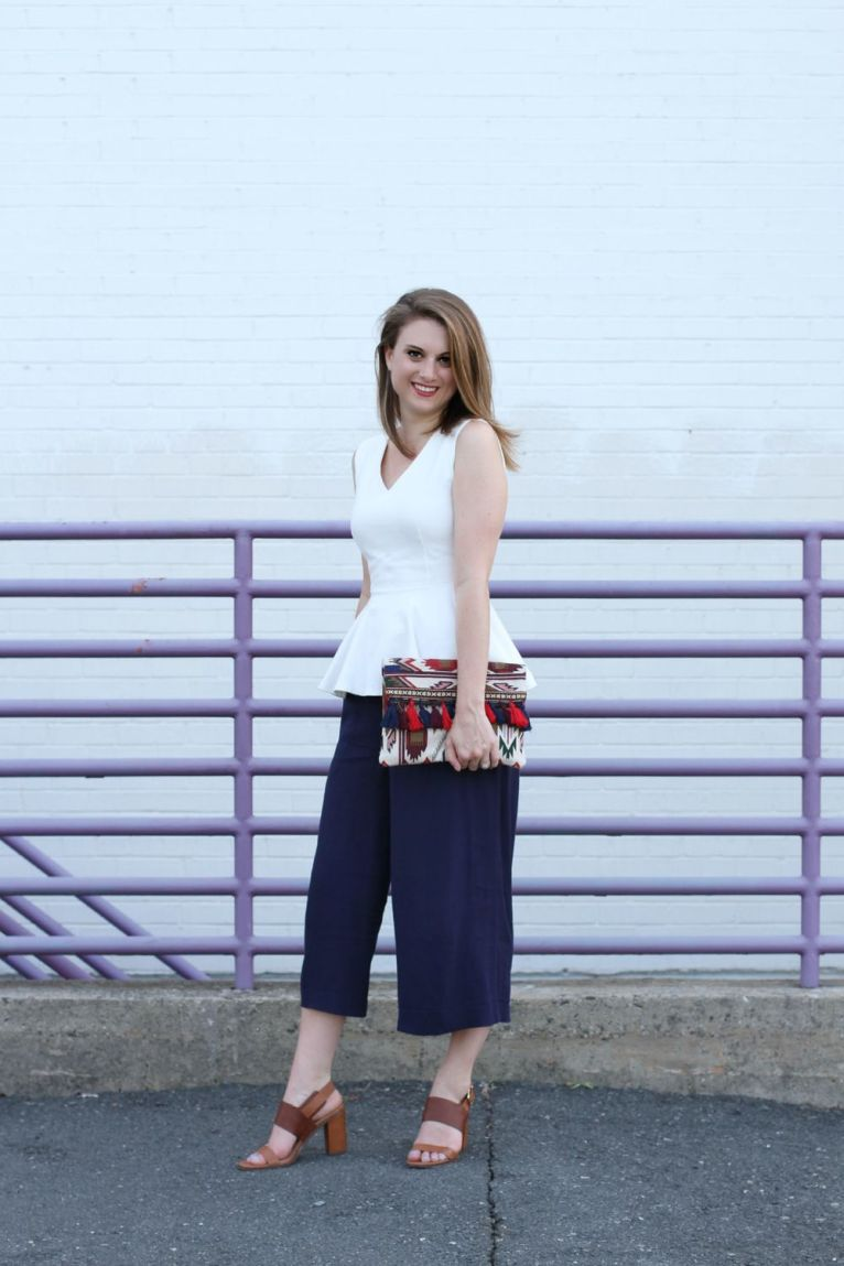 Hobo clutch and navy culottes and white peplum top