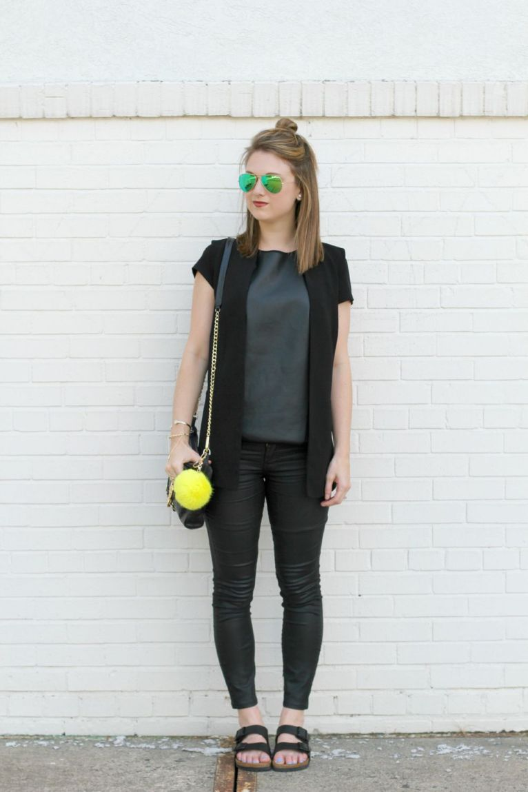 black faux leather jeans and black vest
