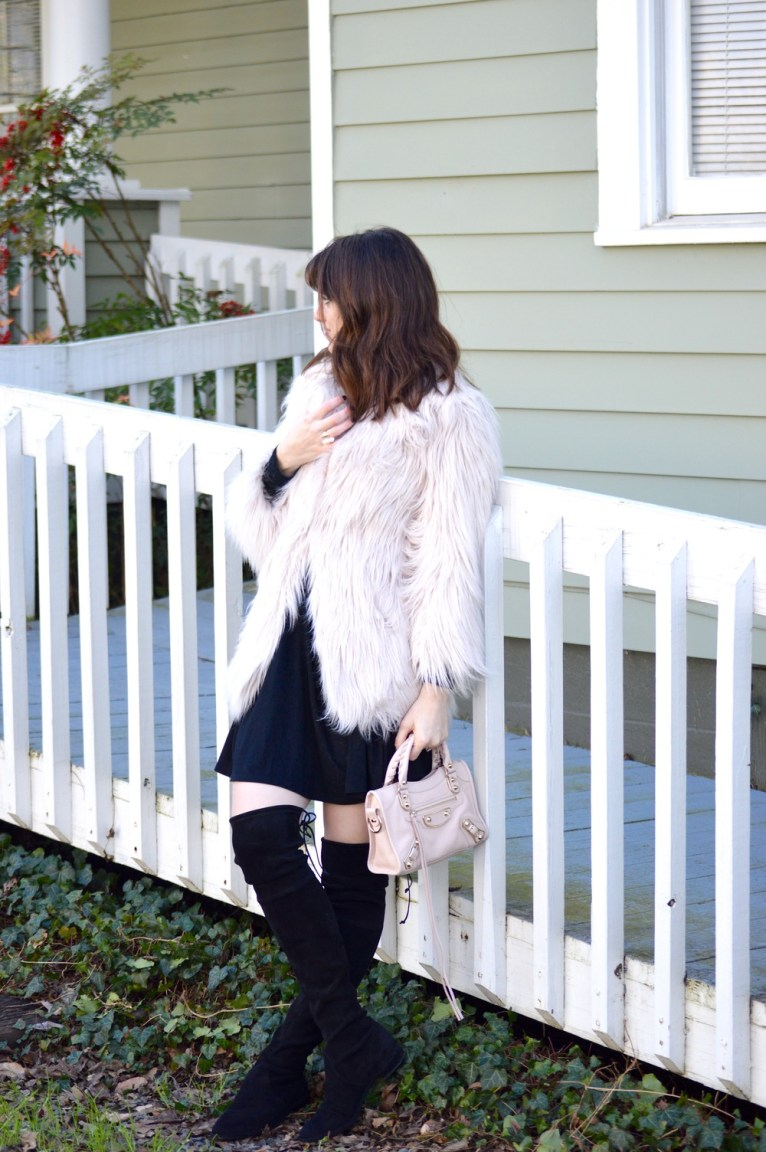 pink faux fur jacket and stuart weitzman lowland boots