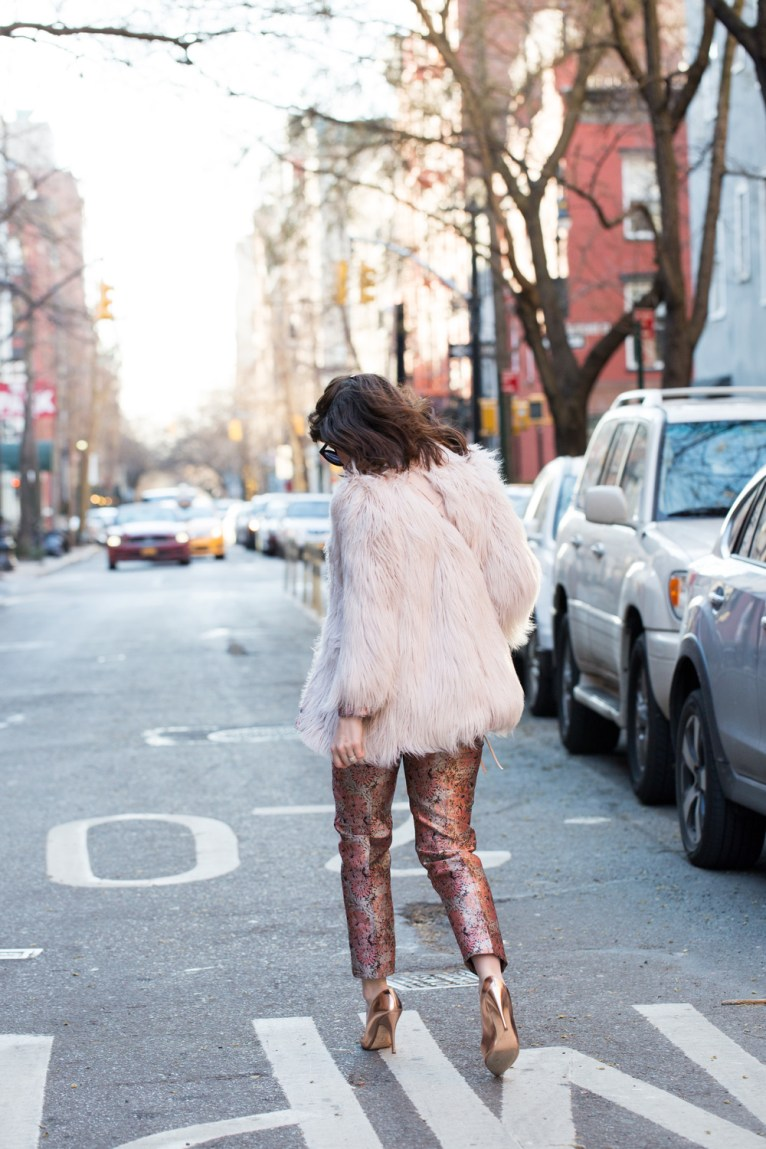 pink faux fur jacket and rose gold shoes