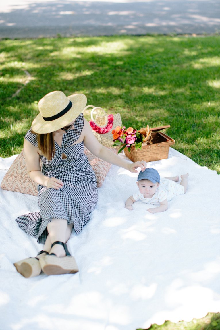 A gingham ruffle dress for a summer picnic with your kids styled by fashion and lifestyle blogger Maggie Kern of Polished Closets