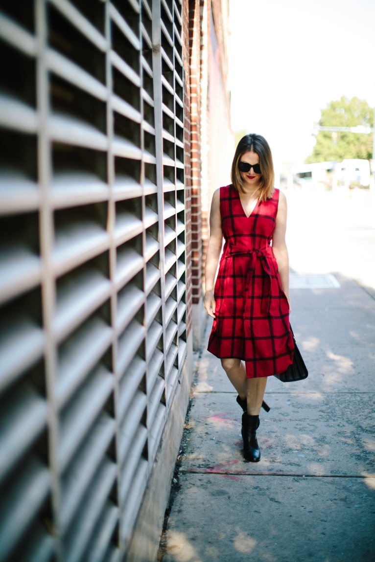 How to wear a red plaid dress for fall by fashion and lifestyle blogger Maggie Kern of Polished Closets.