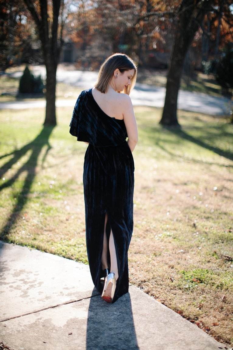 A one-shoulder velvet maxi dress for the holidays and new year by fashion blogger Maggie Kern of Polished Closets.
