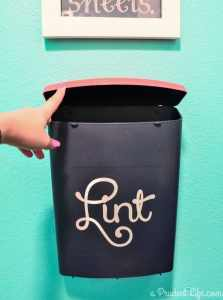 This is a great idea if you don't have room for a trash can in the laundry room - make a wall mounted lint bin next to the dryer!