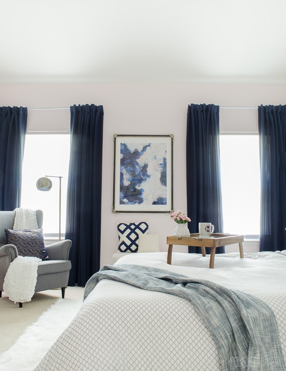 Gorgeous master bedroom with dramatic navy drapes. It's so glam and cozy at the same time.