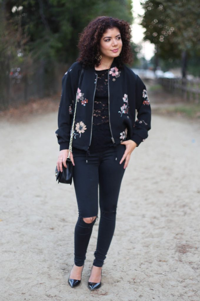 floral bomber jacket with ripped moto jeans and lace tee