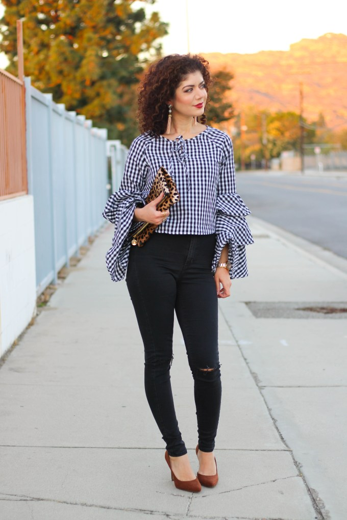 gingham bell sleeve top and black skinny jeans