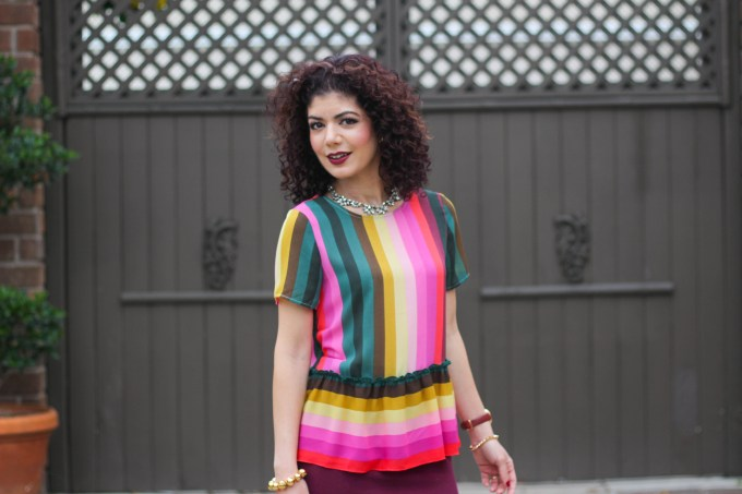 Polished whimsy in multi colored striped shirt and baublebar araksi necklace