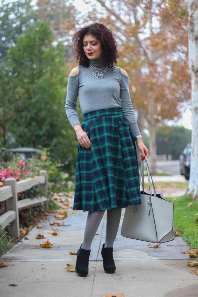 Polished whimsy in green tartan skirt and grey cold shoulder sweater.
