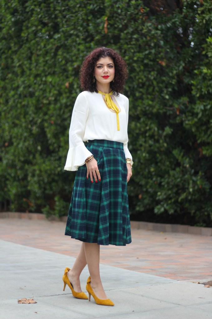 Polished whimsy in green tartan skirt and anthropologie callum tie neck blouse