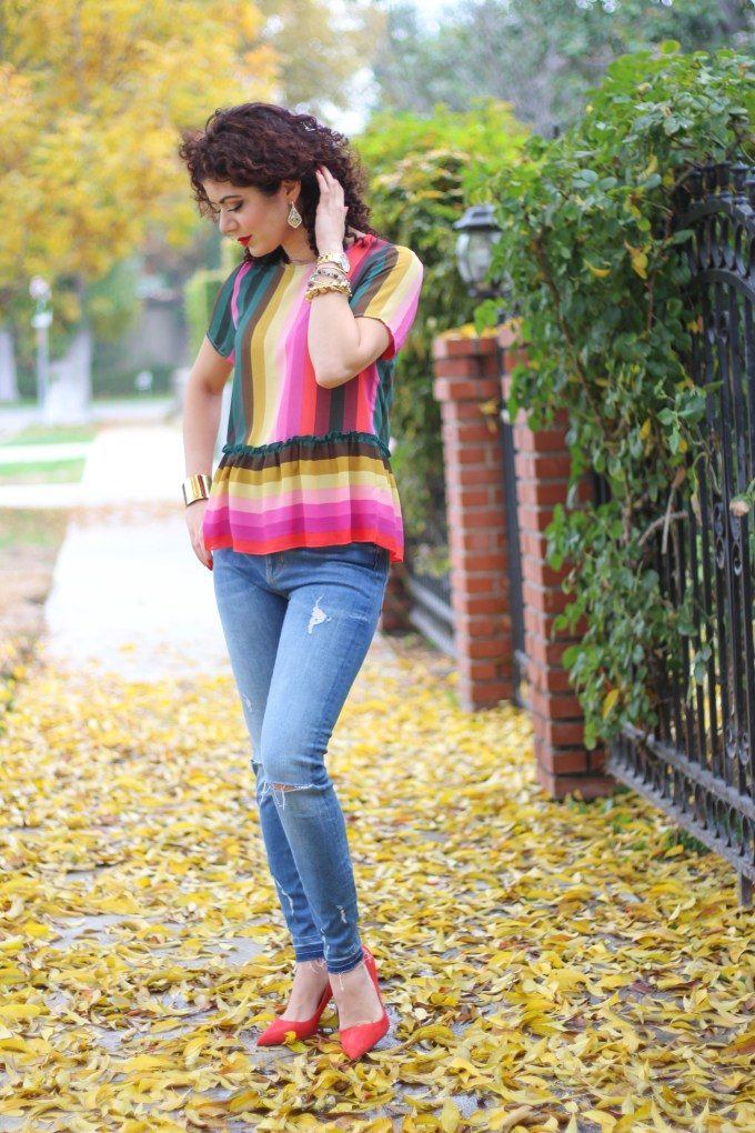 Polished whimsy in multi colored striped shirt and jeans