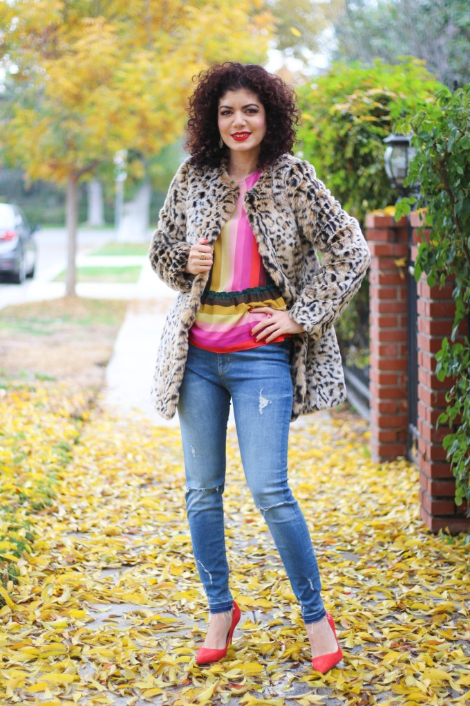 Polished whimsy in multi colored striped shirt and jeans and leopard print coat