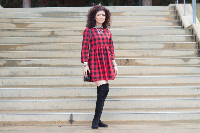 Polished whimsy in buffalo check dress and over the knee boots