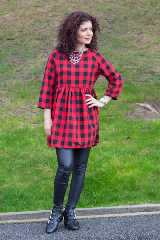 Polished whimsy in buffalo check dress and leather leggings