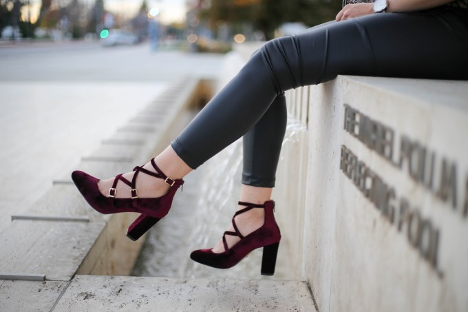 polished whimsy wearing leather leggings and velvet shoes