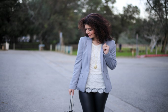 Polished whimsy wears leather leggings for work