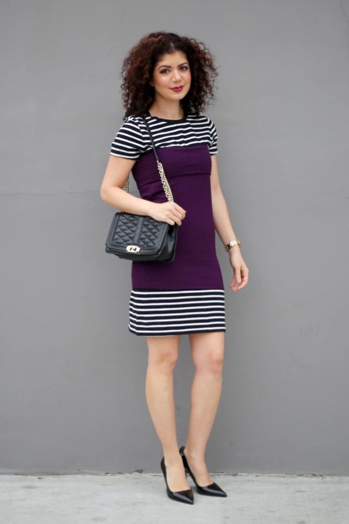 Lu la roe cassie skirt layered over a striped dress
