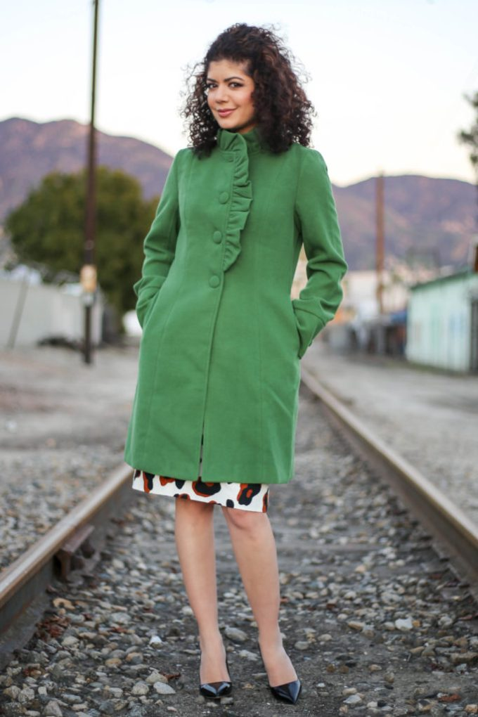Polished whimsy in green coat