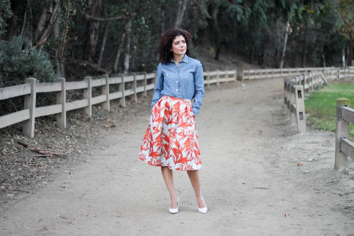 everyday style blogger polished whimsy wearing HM tropical print midi skirt, chambray shirt and white pumps for spring transition outfit