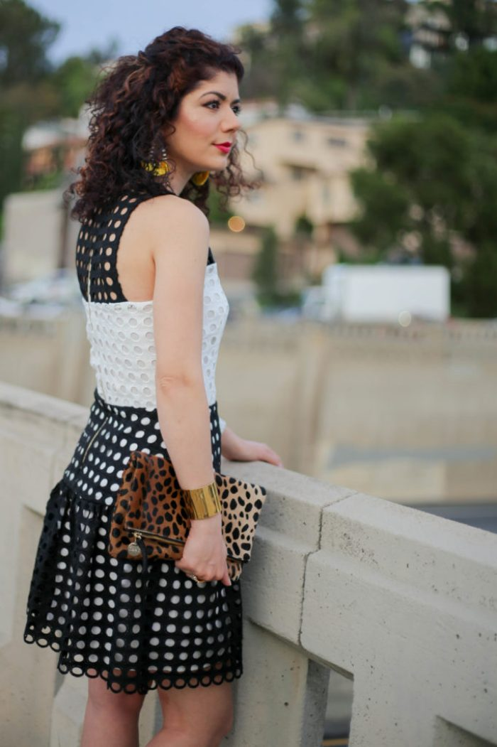 Everyday style blogger polished whimsy wearing devlin color block eyelet lace dress, Clare V leopard print clutch, and baublebar yellow earrings for spring transition outfit