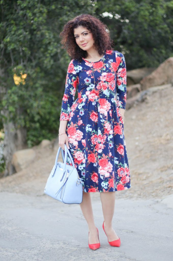 Everyday style blogger polished whimsy wearing examples of light blue and red outfits: baby blue and red floral dress with light blue purse and red pumps
