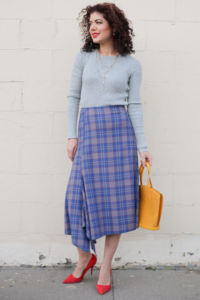 Styling a plaid midi skirt. Fall style | winter style | pretty color combination | Tracy Reese asymmetric plaid midi skirt | Who What Wear side slit button crew sweater | mustard yellow and red | skirt outfit | polished whimsy | everyday style blog | 12 days of skirtmas | how to wear more skirts | red pumps | mustard yellow purse | Louis Vuitton