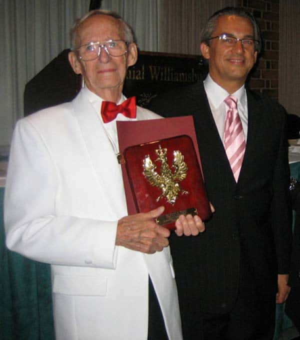 Pictured L-R:  Marion Winters receives Amicus Poloniae award from Counselor Mariusz M. Brymora